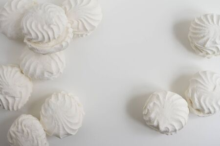 Group of typical latvian marshmallow like sweets called zefiri. High key top view image on white background Stock Photo