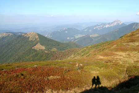 Mala Fatra mountains with a silhouete of pair of tourists Stock Photo - 14481164