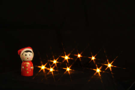 Little Christmas doll with shiny stars