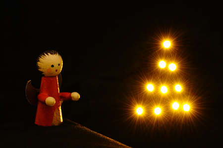 Little Christmas angel with shiny star tree Stock Photo
