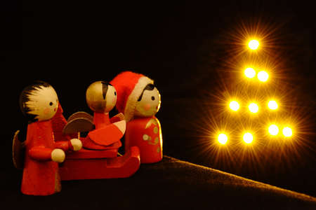 Little Christmas dolls with shiny star tree