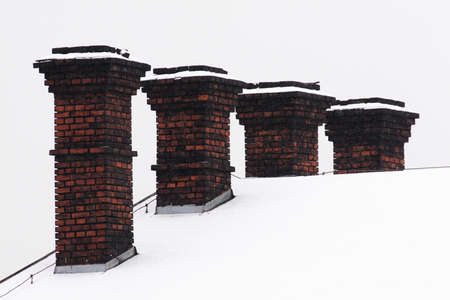 Brick chimneys on the roof of an old factory Stock Photo