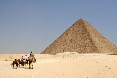 Pyramid and group of wanderers in Egypt