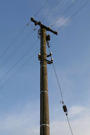 Old wooden pylon of high voltage power line Stock Photo - 18089272