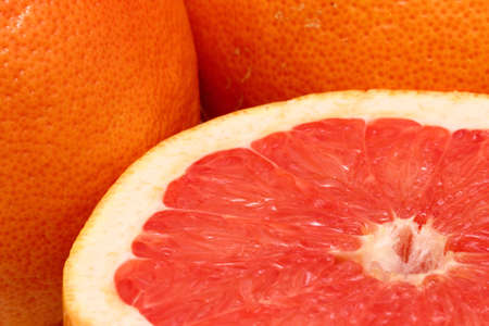 half cut red grapefruit and two others Stock Photo - 18868909