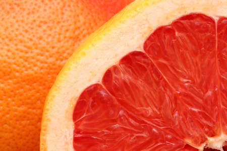 slice of red grapefruit and its skin filling all the frame Stock Photo - 18868912