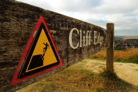 Cliff edge warning sign Stock Photo