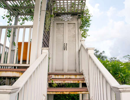 public domain: white staircase door balcony in the park blue sky they are public domain
