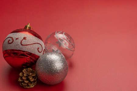 Three christmas balls and a pinecone