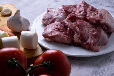 Ingredients for preparing pork cheeks Фото со стока