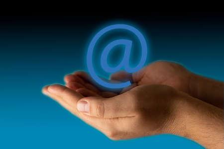 Two hands holding mail symbol Фото со стока