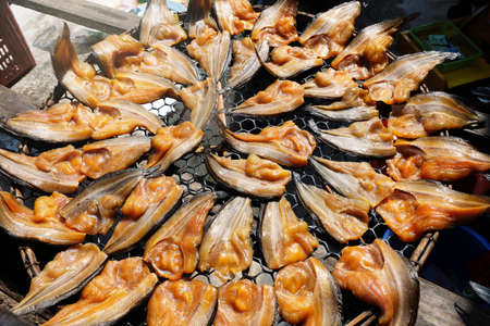 Salted fish is a dry food. . Fish marinated in salty  sauce and dried in the sun to preserve food ,Thai style.Close up and top view. Фото со стока