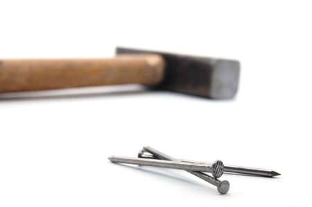 em: Nails and Hammer isolated on whote background.Hammer und Nagel auf weißem Grund. Stock Photo