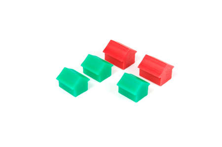mortage: Some red and green houses on a whte backround.