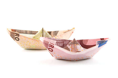 Ship made of money isolated on a white  background. photo