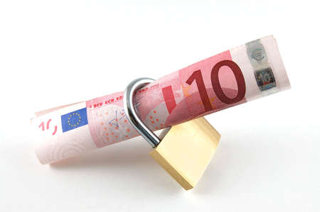 Padlock and money isolated on a white background photo