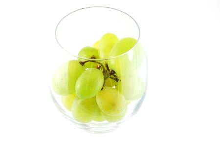 winemaker: Its a grape in a glass isolated on white background.
