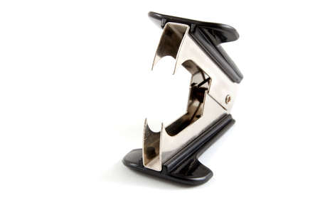 detach: Staple remover isolated on a white background.