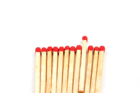Some red matches isolated on a white background. photo