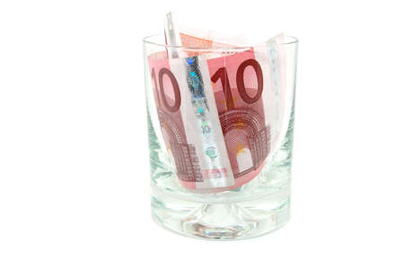 Some euro banknotes in a tumbler isolated on white background photo
