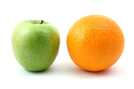 antipode: Apple and orange isolated on a white background