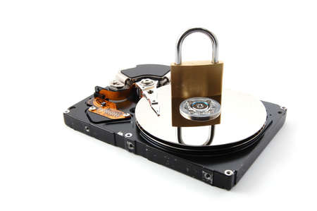 computer hard disk drive and a padlock isolated on white background photo