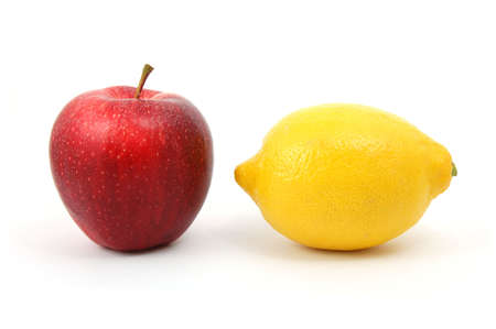 antipode: apple and lemon isolated on a white background