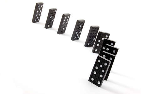 gambling stone: chain of dominoes isolated on a white background Stock Photo