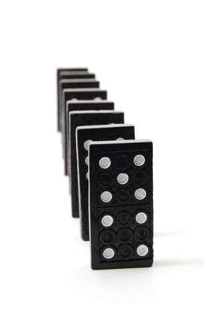 consequence: chain of dominoes isolated on a white background Stock Photo
