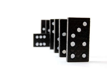 affinity: row of dominoes including a special domino stone isolated on white background Stock Photo