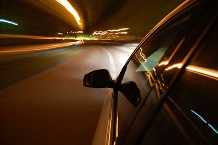tunnel view: night drive with car in motion through the city shows the speed