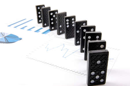 some domino stones on a blue  business chart  photo
