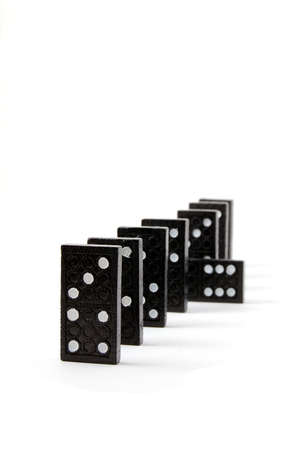 row of dominoes including a special domino stone isolated on white background Stock Photo - 3675551