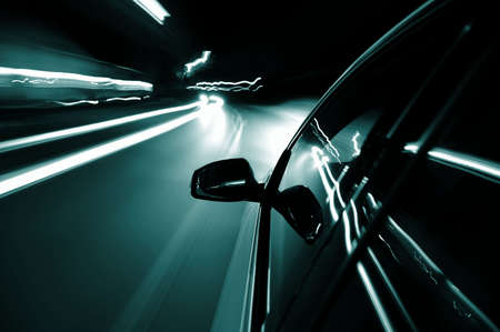 road tunnel: night drive with car in motion through the city shows the speed
