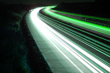 road with car traffic at night and blurry lights showing speed and motion Stock Photo - 3739684