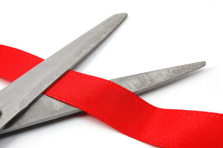ceremonial: scissors and red ribbon isolated on white showing a ceremonial opening