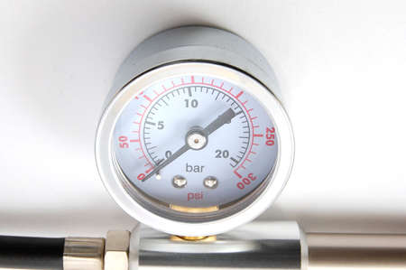 high pressure barometer of a pump on white background photo
