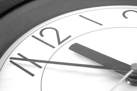 wall clock at 12. time is running out Stock Photo