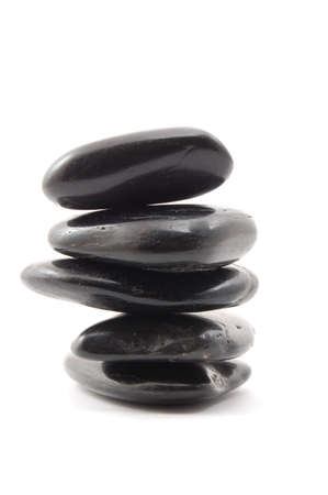 black stones in balance isolated on white background photo