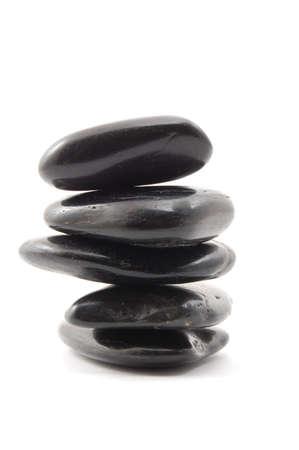 black stones in balance isolated on white background photo