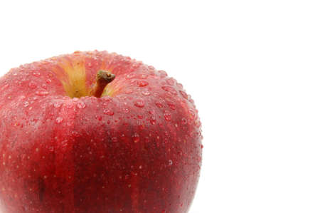 vitamines: fresh red apple with water drops isolated on white background