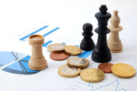 chess man over business chart admonish to strategic behavior photo