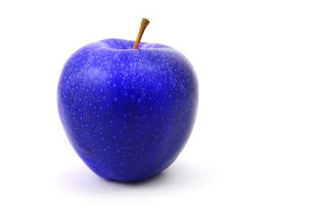 unnatural: a blue apple fruit isolated on white background Stock Photo