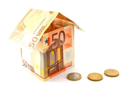 domiciles: house made of euro money bils isolated on white background Stock Photo