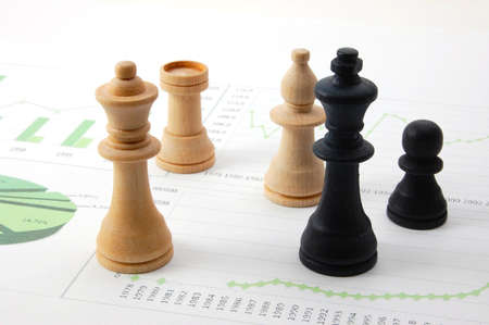chellange: chess man over business chart admonish to strategic behavior