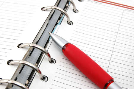 business organizer on white background with pen Stock Photo - 4032738