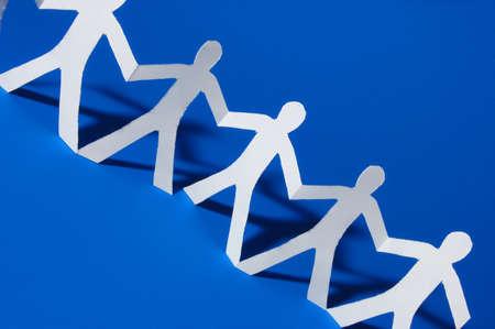 sozialarbeit: Team von Menschen mit einer Papier-Partei Lizenzfreie Bilder