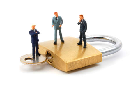 business man on secure pedlock isolated on white background Stock Photo - 4086498