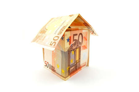 housebuilding: house made of euro money bils isolated on white background Stock Photo