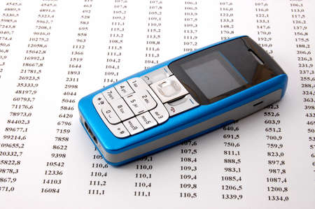 blue cell phone over business chart showing success Stock Photo - 4097162